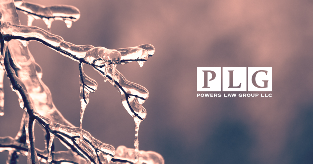 image of icy branch for a blog about wintertime personal injury risks