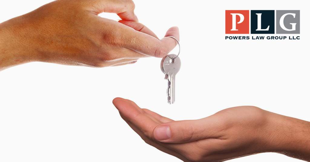 Picture of a person handing over a set of keys for blog on Landlords and Tenants